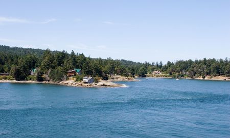 Cottages along the coastalline of Gulf Islands. British Columbia.