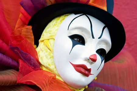 buffoon: Clown in white mask, and top hat - close up