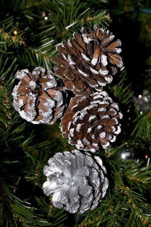 Silver pine cones on Christmas tree Stock Photo