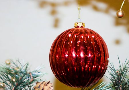 Red Christmas ornament hanging, with copy space to the left Stock Photo