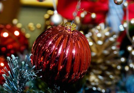 Red bauble ornament on the Christmas tree.