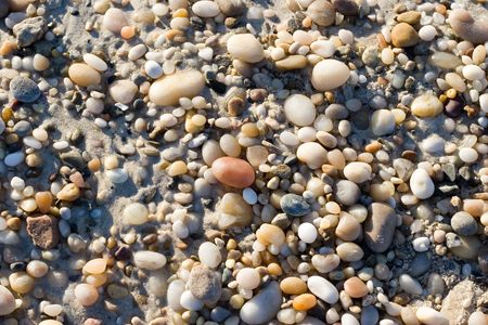 Background made of warm colors beach pebbles