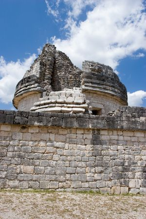 Mayan heritage in Chichen Itza, - the wall of Observatory El Caracol (Fragment) on the blue sky, Yucatan, Mexico