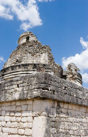 Mayan heritage in Chichen Itza, - the wall of Observatory El Caracol (Fragment) on the blue sky, Yucatan, Mexico.
