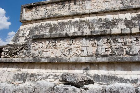 Mayan figures carved into the old stone wall at Chichen Itza. Mexico  Stock Photo