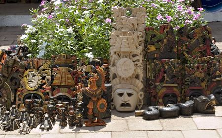 souvenirs: Traditional Mayan Masks and Souvenirs for sale at Chichen Itza.