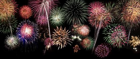 lanscape: Large background of fireworks that you can apply to your design. This image is a composite of 10 separate photographs of real fireworks. The background is black so you can easily overlay it over any lanscape or city scape.