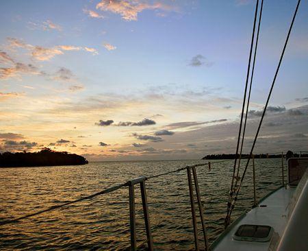 Catamaran sail at sunrise. Crawl Caye, Belize. Caribbean islands.