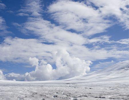 Dramatic clouds gathering above the glacier n Alaskas Southwestern Coast near Scagway.