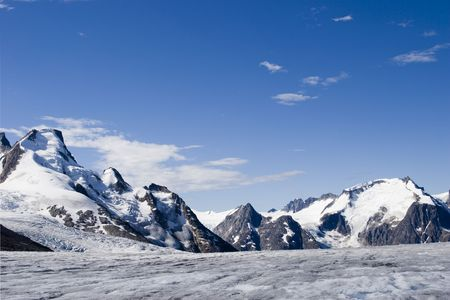 Jagged Peaks of one of the most spectacular glaciers on Alaskas Southwestern Coast near Scagway. Stock Photo
