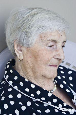 A portrait of a senior woman.