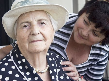 elderly care: two mature women: mother and daughter Stock Photo