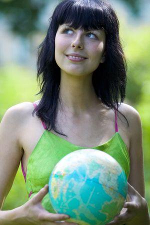 beautiful brunet woman with global photo