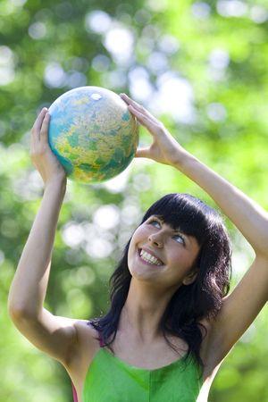 beautiful brunet woman with global Stock Photo - 3305917