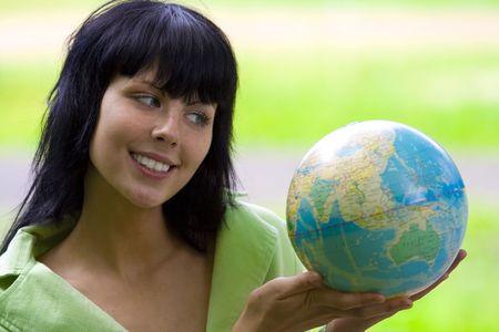 brunet bisnesswoman with global photo