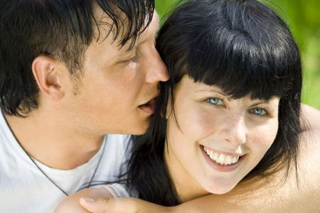 a young couple having fun in the park photo
