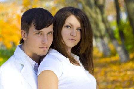 young happing couple in autumn park photo