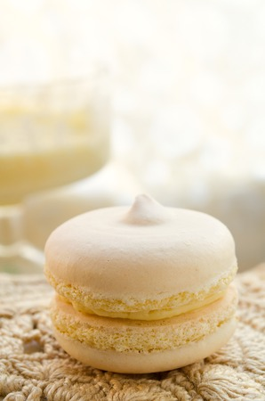 curd: Homemade yellow french macaroons with lemon curd