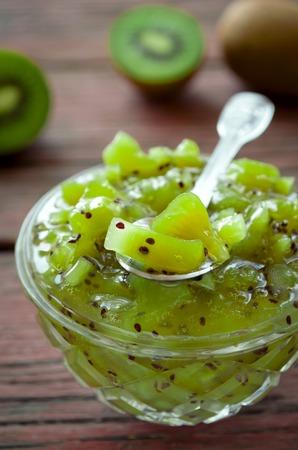 preserve: Fresh homemade green kiwi jam on a wooden rustic table