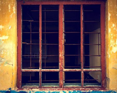iron curtains: Rusty iron grid instead of window on a grunge yellow background
