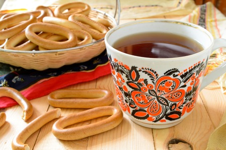 baranka: traditional Russian tea-party with cracknels on wooden table.