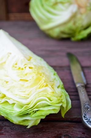white headed: ripe white headed cabbage on a wooden table.