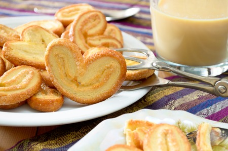 sweet pastry: Palmeras - sweet puff pastry. Heart shaped cookies with sugar.