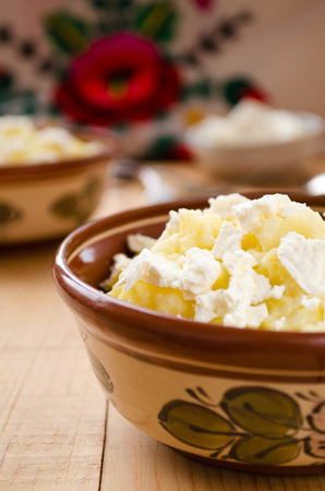 goat cheese: Traditional Ukrainian millet-porridge with butter and goat cheese Foto de archivo