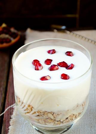 oatmeal: Healhty breakfast with oatmeal, greek yogurt and pomegranate berries on wooden table