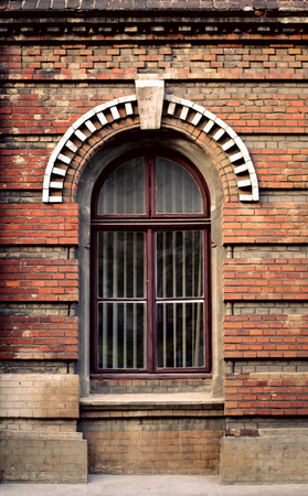 windows frame: Old wooden windows frame on cement cracked wall. Vintage facade.