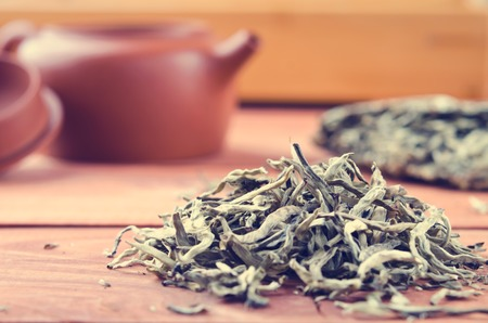 Chinese pressed white tea, silver needle. Selective focus