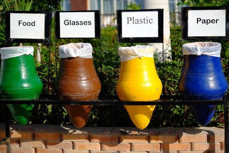 garbage collection: Colorful ceramic pots for separate garbage, collection of recycle materials