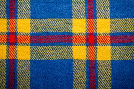 warm cloth: Blue vintage blanket tartan plaid wth copy space, texture background.
