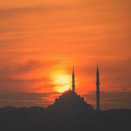 Mosque silhouette on The sunset and two minarets. Square, copy space, toned Stock Photo