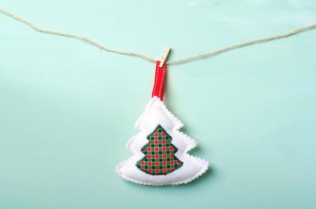Christmas decoration tree hanging on turquoise background Stock Photo