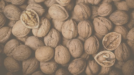 Whole Walnuts background, food concept. Top view