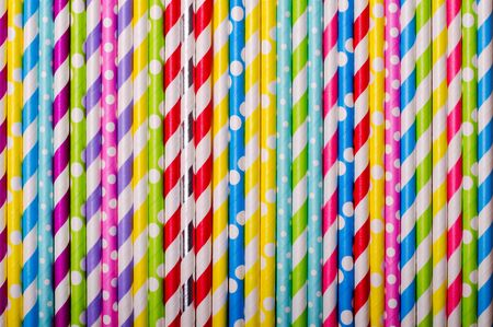 Colorful drink straws for background, top view. Horizontal