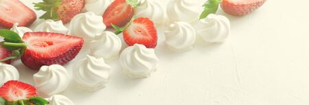 Pattern with strawberries and meringues on white background. Banner, toned