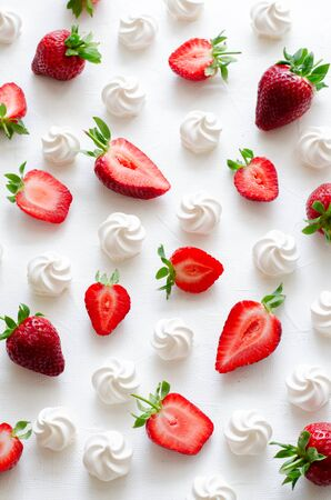 Pattern with strawberries and meringues on white background. Vertical Standard-Bild