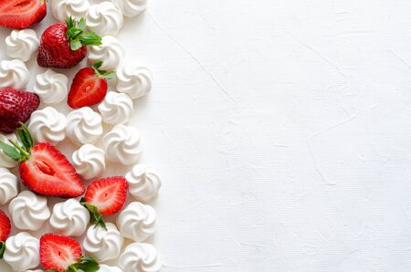Pattern with strawberries and meringues on white background. Horizontal, copy space