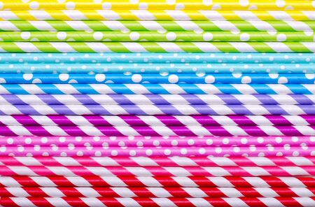 Colorful drink straws arrange in gradient, for background, top view. Horizontal