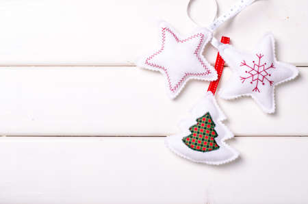 Christmas decorations with stars and tree on white wooden background. Xmas and Happy New Year composition