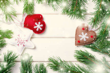Christmas decorations stars and tree with Fir branches on white wooden background. Xmas and Happy New Year composition.