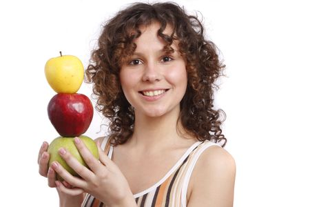 Young smiling woman with three apples. Attractive girl is holding the pyramid of apples. Isolated over white. Stock Photo - 4880242