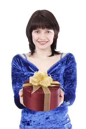 Beautiful smiling woman with a gift. Attractive girl holding purple box with gold ribbon. Pretty teenager is giving a present. Isolated over white background Stock Photo - 4880249