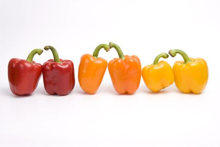 Bright colorful pepper isolated on white. Amorous twosomes of colorful sweet peppers. Stock Photo - 4928755