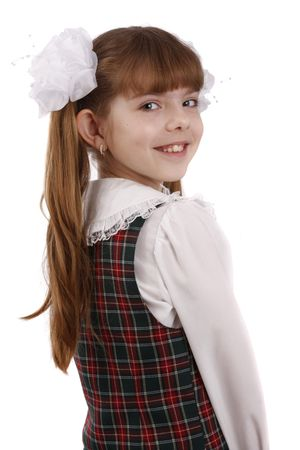 school uniform girl: Portrait of smiling, little girl in school uniform. Young pupil is going to school. Isolated on white in studio.