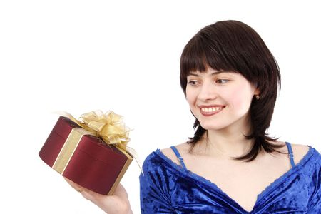 Beautiful smiling woman with a gift. Attractive girl holding purple box with gold ribbon. Isolated over white background. Happy girl is surprising at present. Stock Photo - 5026631