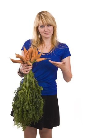 Picture of a beautiful smiling girl holding bunch of carrots against background.