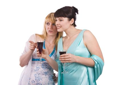 Girl telling a secret to another - gossip isolated over a white background. Woman friends series. Two happy women sharing funny gossip. Girl in greenness of the sea dress is standing and holding wine glass. Woman in white dress is telling a secret to anot Stock Photo - 5638921